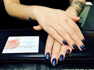 Gel nails with blue glitter